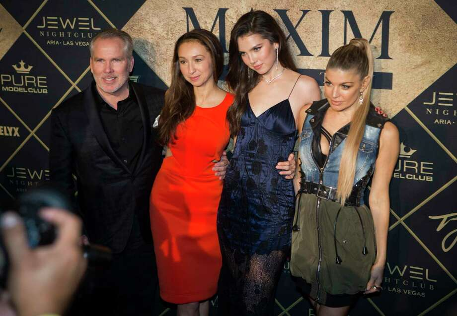 Thomas J. Henry, his longtime partner Azteca Henry, their daughter Maya Henry and entertainer Fergie pose for photographs at the Maxim Super Bowl Party 2017, presented by Thomas J. Henry at the Smart Financial Centre at Sugar Land on Feb. 5, 2017. Photo: Marie D. De Jesus /Staff File Photo / © 2017 Houston Chronicle