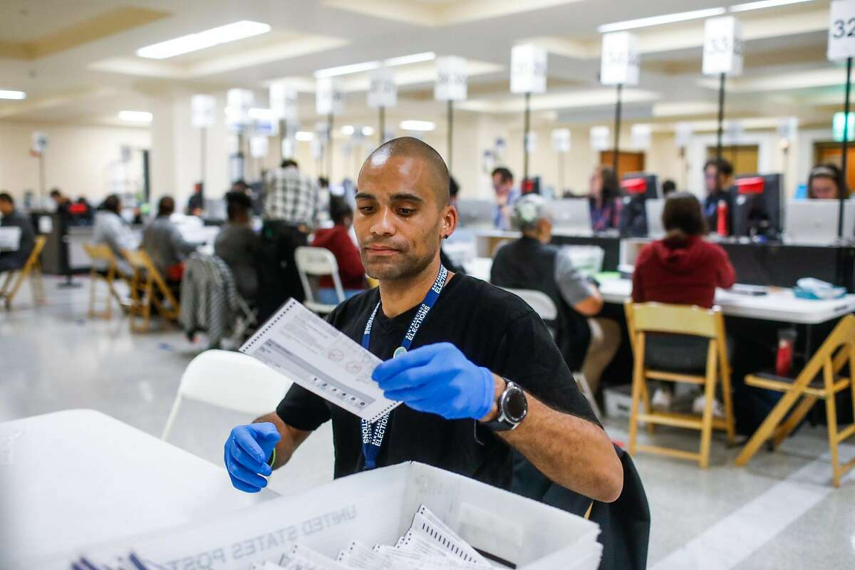Marion Gautier helps to organize and count absentee and mail-in ballots following the elections yesterday a the Department of Elections at City Hall in San Francisco, California, on Wednesday, Nov. 6, 2019.