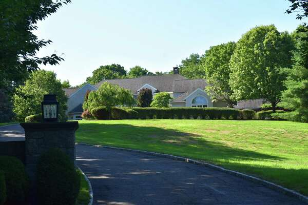 A six-bedroom home on Singing Oaks Drive in Weston, Conn., sold for $1.7 million at the close of June 2020 as the town's real estate market heated up in the second quarter.