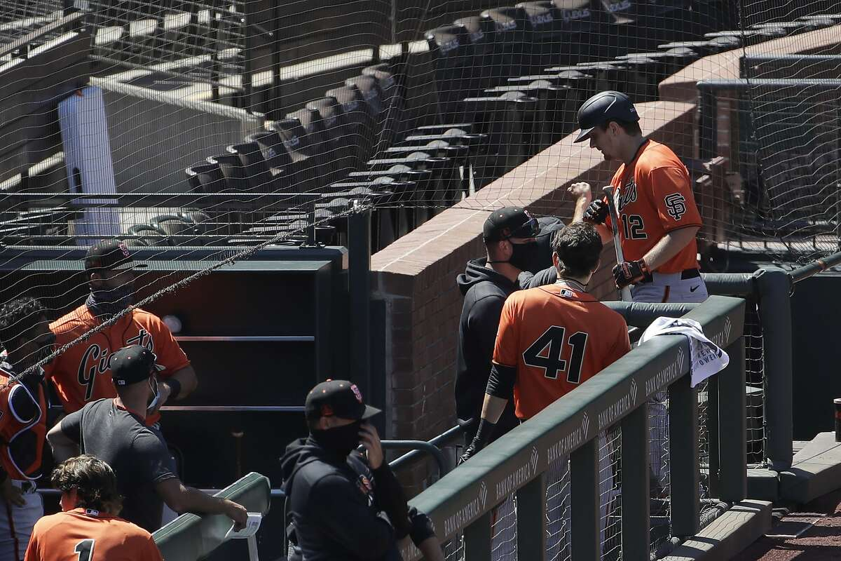 San Francisco Giants' Alex Dickerson, right, is greeted after hitting a home run during baseball practice in San Francisco, Tuesday, July 14, 2020. (AP Photo/Jeff Chiu)