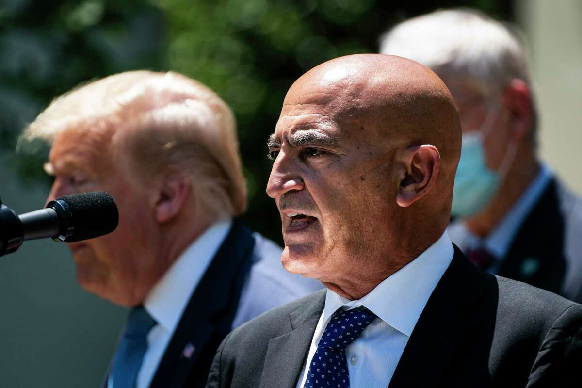 Moncef Slaoui, a former GlaxoSmithKline executive, speaks with President Trump during a vaccine development event in the Rose Garden at the White House on May 15.