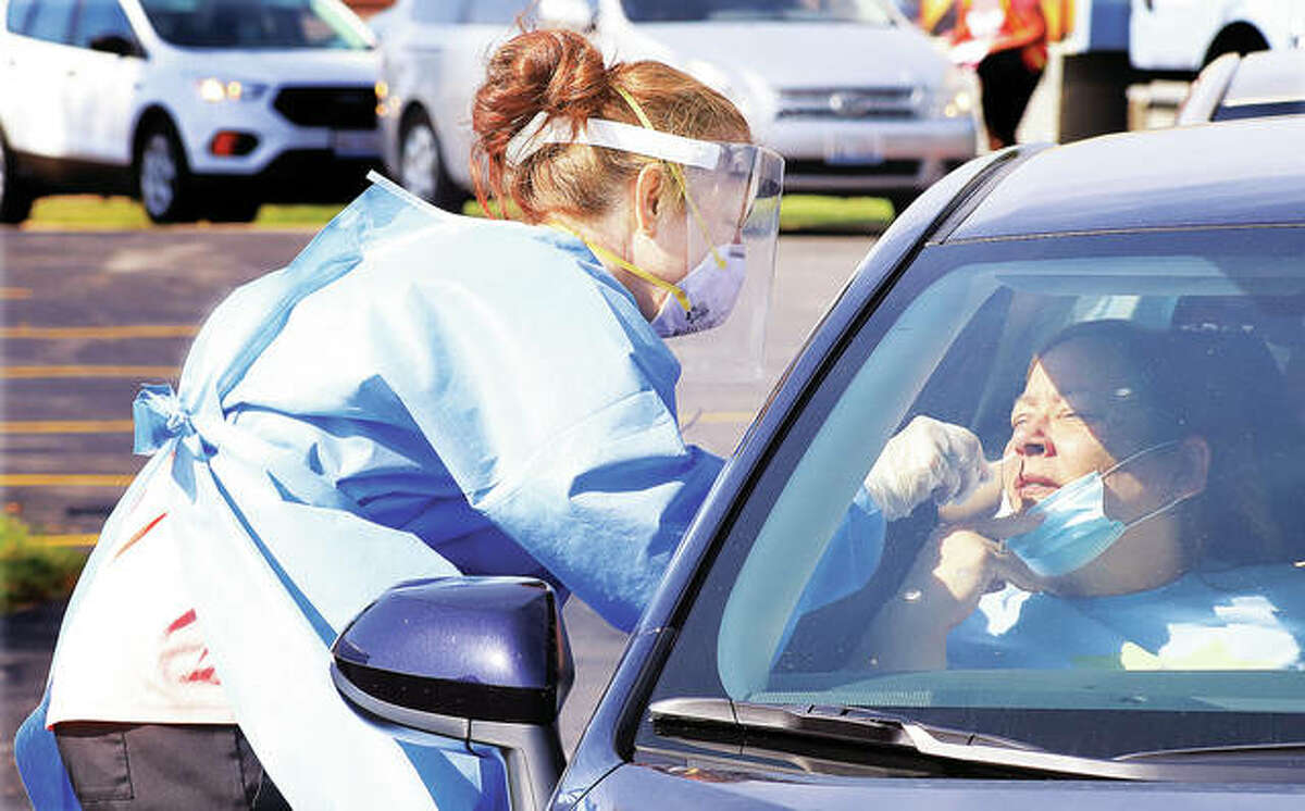 People began lining up as early as 7 a.m. Tuesday for the 9 a.m. start of drive-up testing for COVID-19 Tuesday behind the Godfrey Village Hall. Hundreds of people were tested for the virus by the Madison County Health Department.