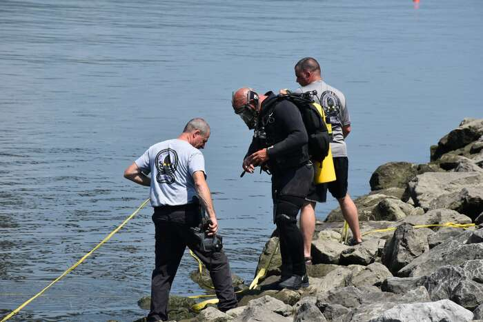 State Police and others are seen at the scene of the recovery of a car in the Hudson River with human remains inside on July 8, 2020, in Poughkeepsie.