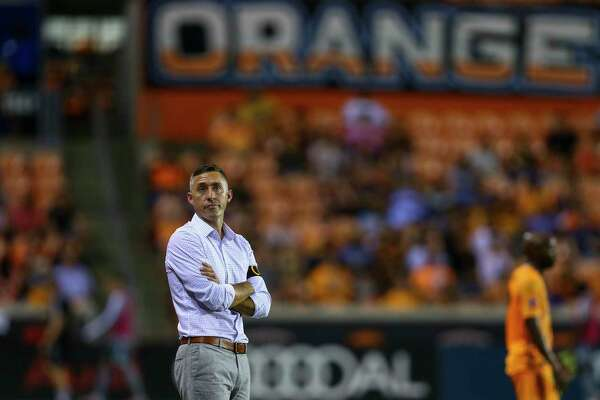 Houston Dynamo head coach Davy Arnaud looks up to the scoreboard during the first half of an MLS match against Minnesota United FC at BBVA Stadium Wednesday, Sept. 11, 2019, in Houston. The Dynamo won 2-0.