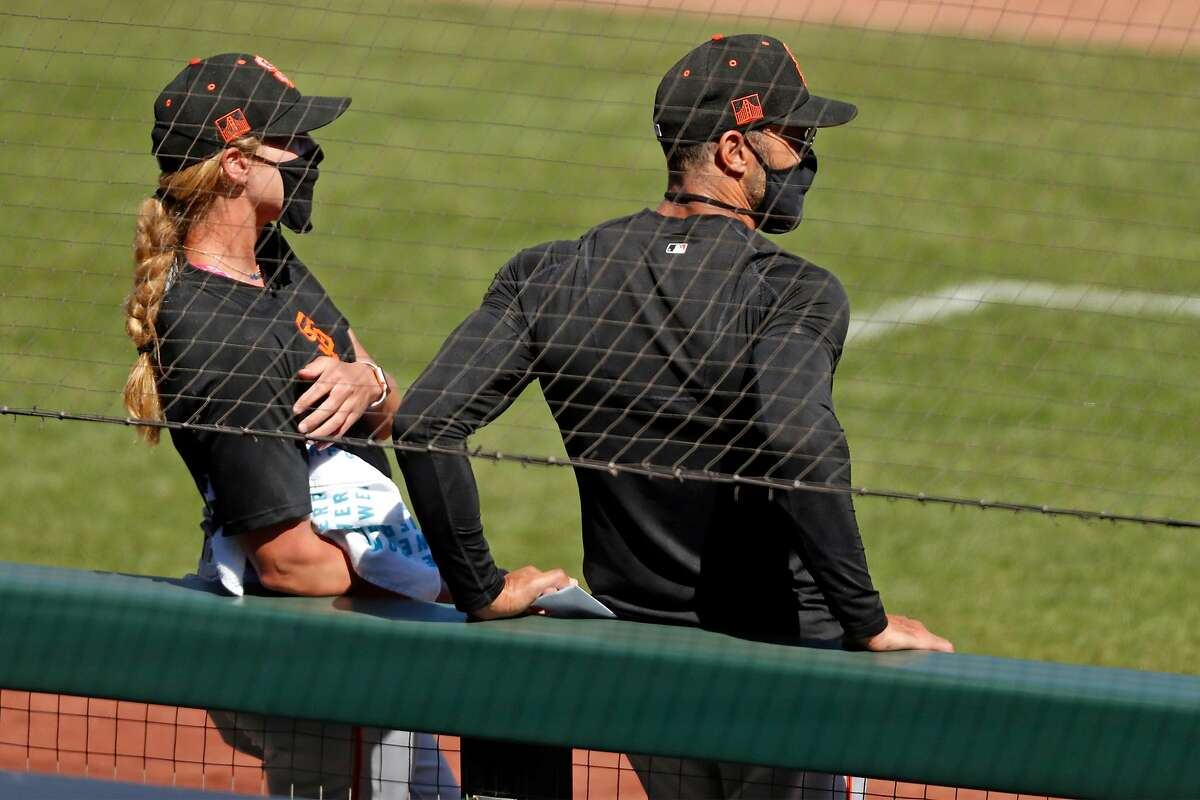 San Francisco Giants' coach Alyssa Nakken (left) and manager Gabe Kapler during intrasqaud game at Oracle Park in San Francisco, Calif., on Tuesday, July 14, 2020.