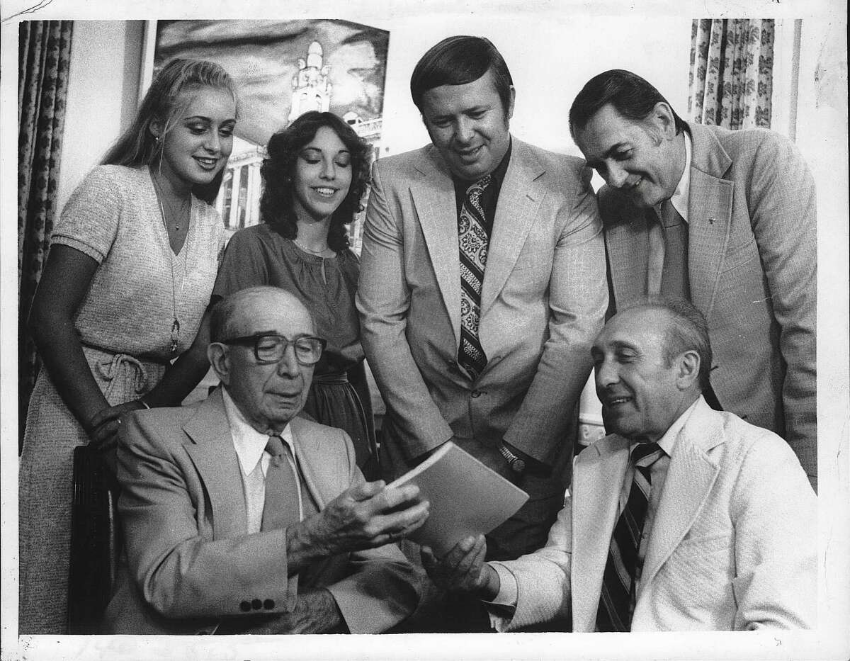Gathered at Mayor Frank Duci's office in City Hall, Schenectady, New York, this group is planning for Kiwanis Kids Day. Seated are William Golub,