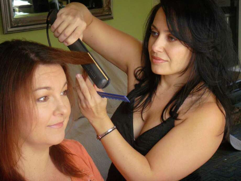 "Gina Bonacquisti, right, grew up in East Greenbush and now works in Los Angeles as a hairstylist in the entertainment industry. She has been nominated for two Emmy Awards for her work on ""Glee."" Here, she styles the hair of Stefanie Owens, a friend and makeup artist, in Los Angeles."