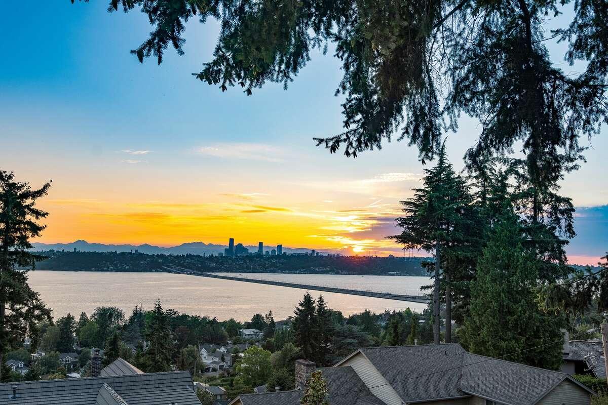 Views are panoramic, encompassing city skyline, lake and mountains.