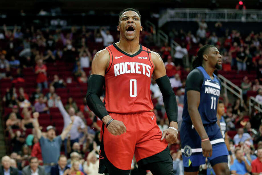 Houston Rockets guard Russell Westbrook (0) reacts after a dunk next to Minnesota Timberwolves center Naz Reid (11) during the second half of a March, 2020 NBA basketball game in Houston. Photo: AP Photo