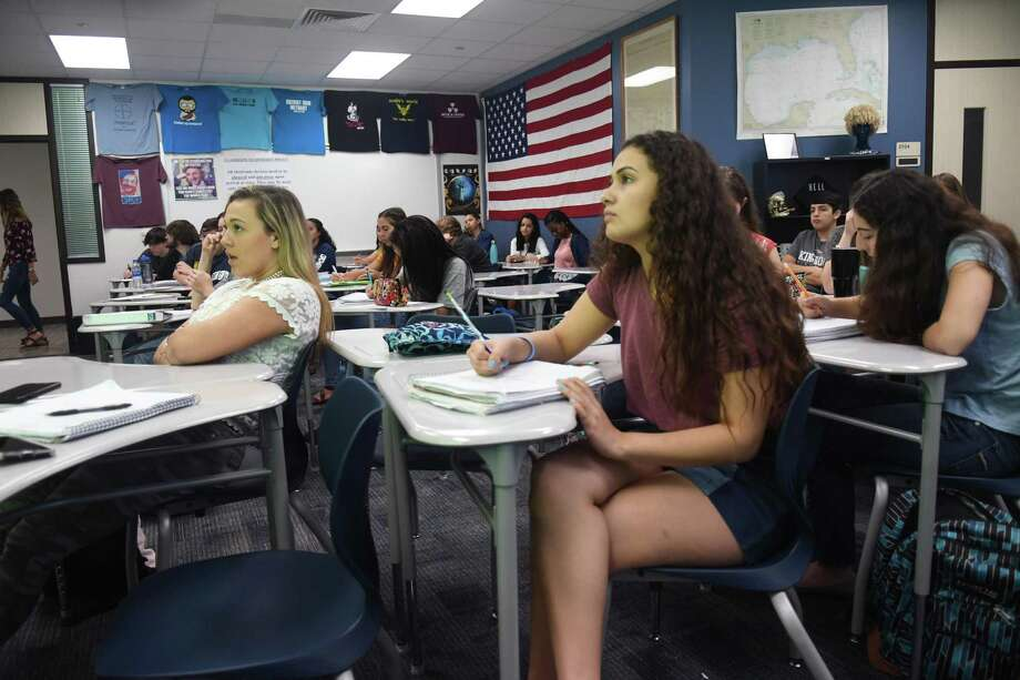 Melissa Reeves, 17, from left, and her Kingwood High School junior classmate Marissa Amar, 17, the KHS Student Body President, listen during an AP Dual Credit History class taught by teacher Mark Scalia during their first day back on the KHS campus for the 2017-2018 schoool year on Monday, March 19, 2018. (Photo by Jerry Baker/Freelance) Photo: Jerry Baker, Freelance / For The Chronicle / Freelance