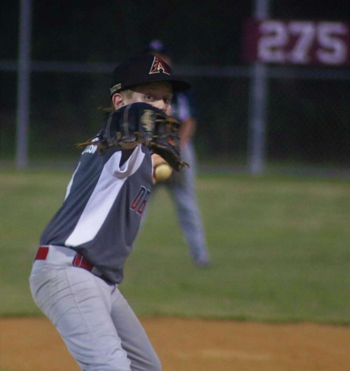 Jack Paradysz peers over his glove as he works on a batter Tuesday night. En route to picking two Pirates off first base, the southpaw nabbed the win on the mound.