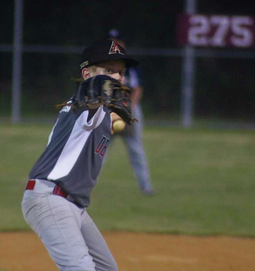 Jack Paradysz peers over his glove as he works on a batter Tuesday night. En route to picking two Pirates off first base, the southpaw nabbed the win on the mound. Photo: Robert Avery