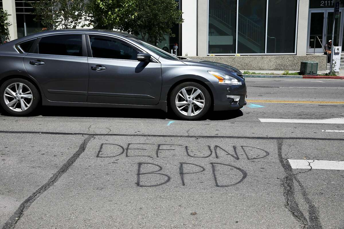 """A message stating, """"Defund BPD,"""" is spray painted on the street near the Berkeley Police Department, located at 2100 Martin Luther King, Jr. Way, on Tuesday, July 14, 2020, in Berkeley, Calif. On Tuesday, the Berkeley City Council will consider a series of public safety reform proposals, including the a 50% Reallocation of Police funds bill that will slash the police budget from $72 million to $36 million, the BerkDOT proposal to eliminate police from traffic enforcement, and the George Floyd Community Safety Act to analyze police call data."""
