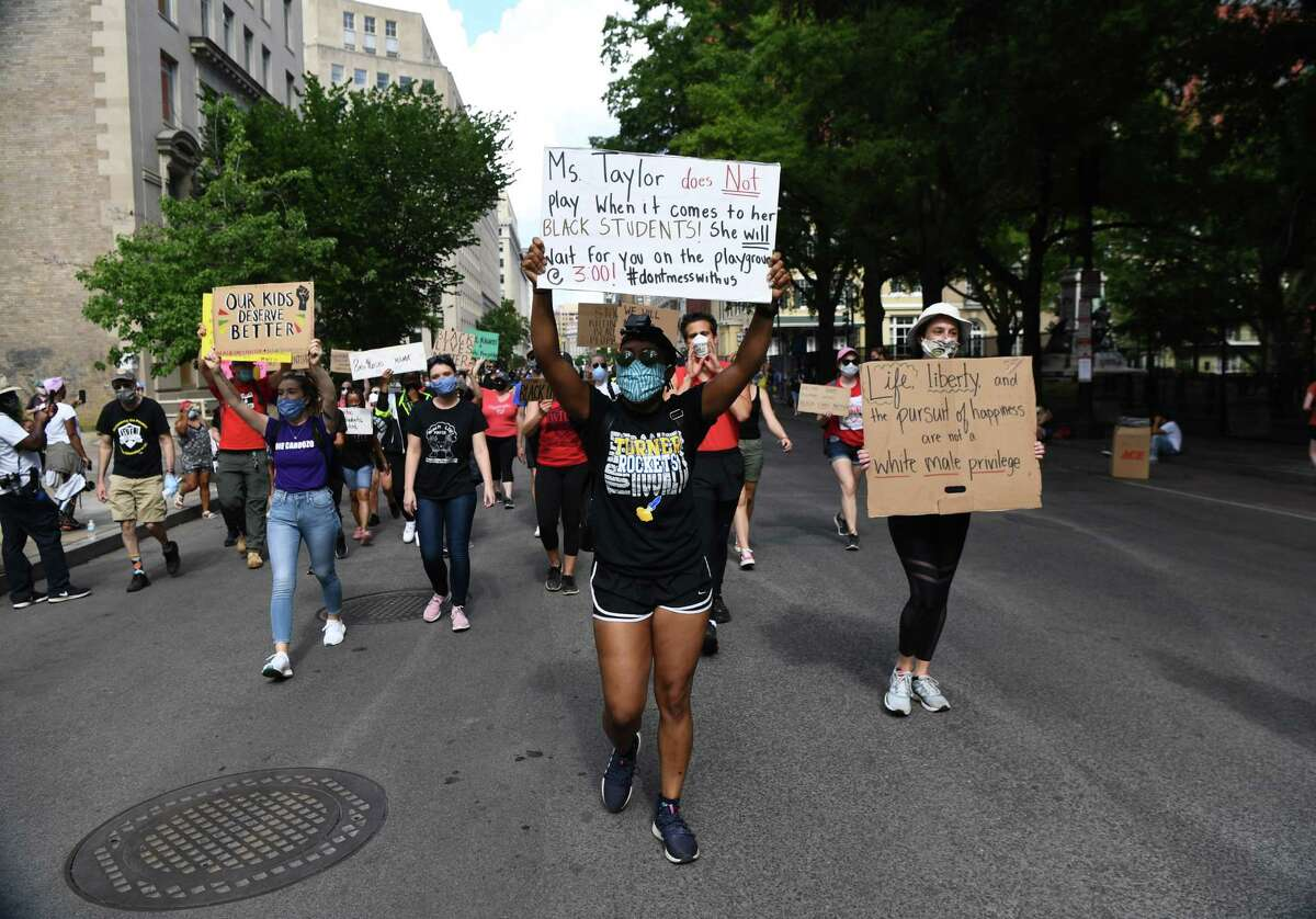 Nandi Taylor (center) a fifth-grade teacher, and others take part in protests June 5 near the White House.