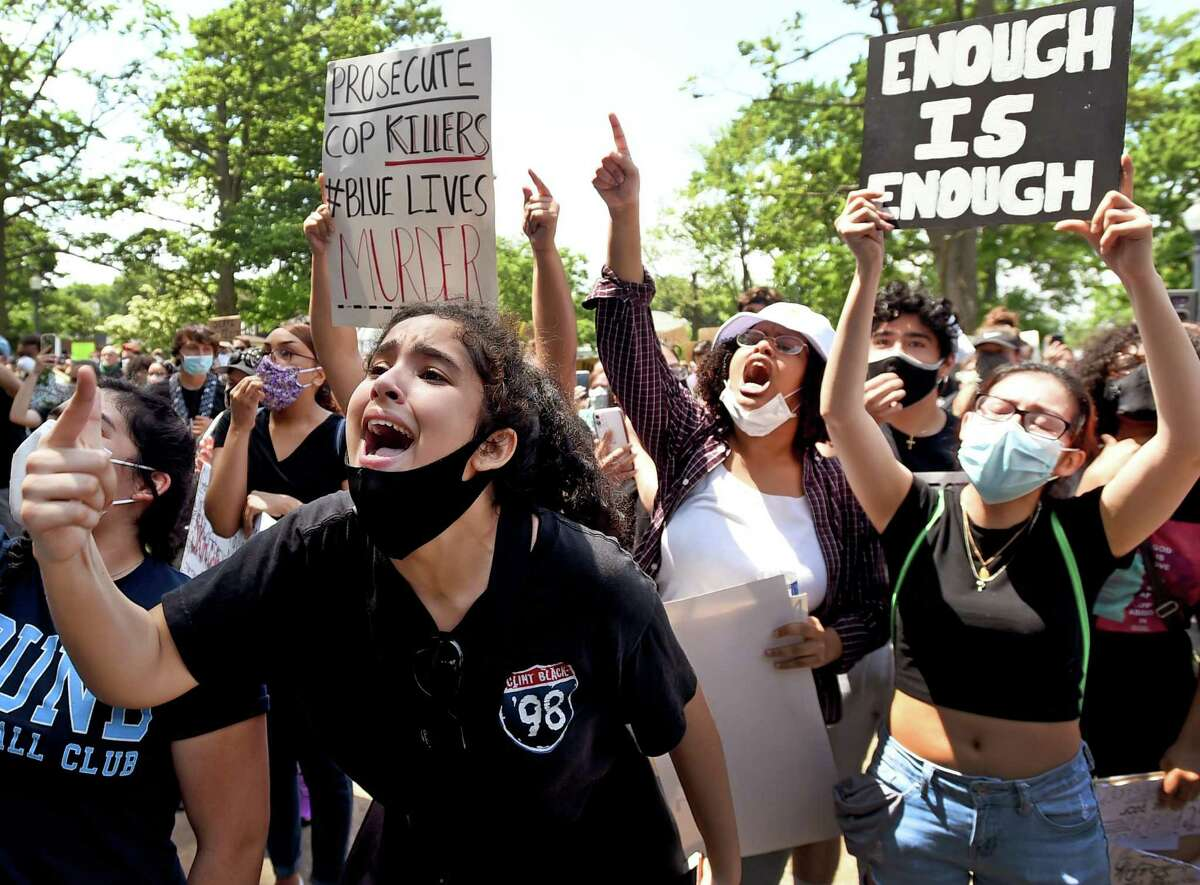 Farah Najjari, 17, of Wet Haven, left, and Rua Osman, of West Haven, right, rallied last month on the West Haven Green and marched to the West Haven Police Department protesting police brutality, including the death of Mubarak Soulemane of New Haven who was fatally shot by a Connecticut state trooper in January.