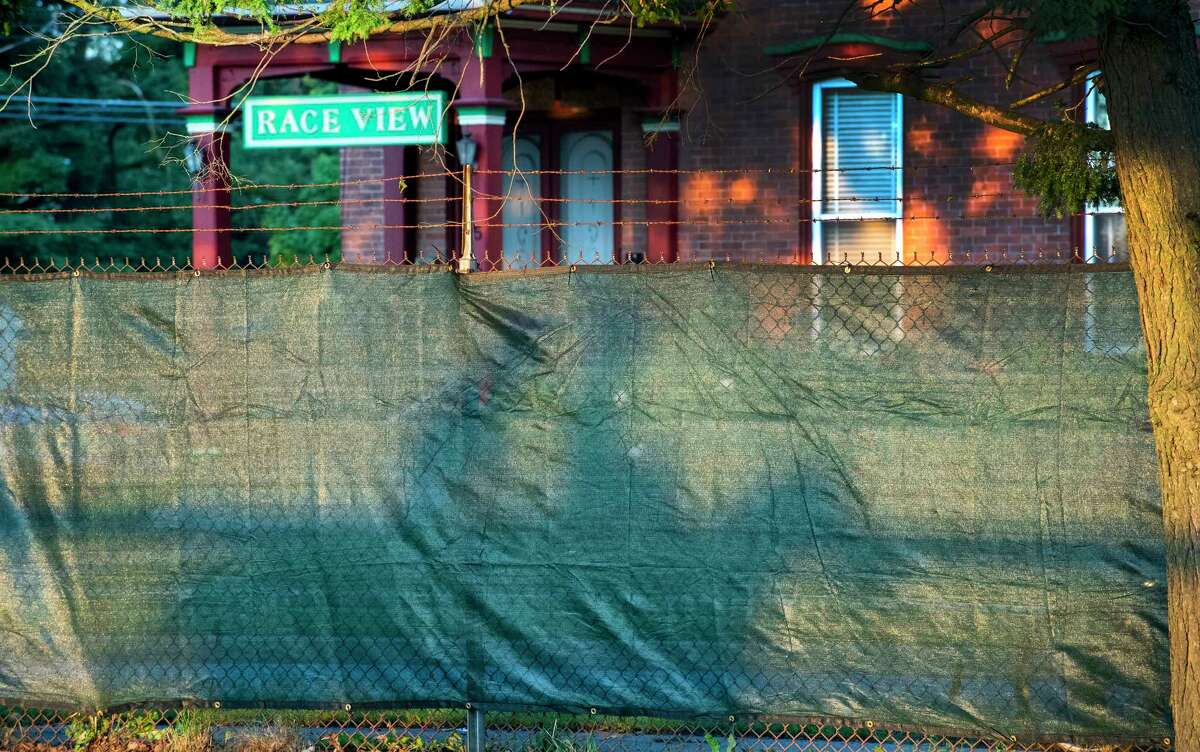 Exercise rider's shadows are captured on the new privacy fence in stalled on the Nelson Avenue side of the main track the day before opening day at Saratoga Race Course July 15, 2020 in Saratoga Springs, N.Y. Photo by Skip Dickstein/Special to the Times Union.