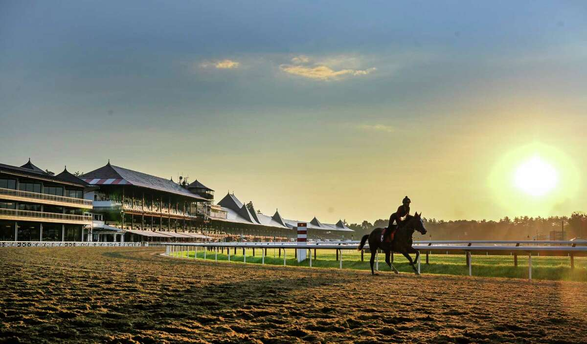 Horses gallop in the early morning the day before opening day at Saratoga Race Course July 15, 2020 in Saratoga Springs, N.Y. Photo by Skip Dickstein/Special to the Times Union