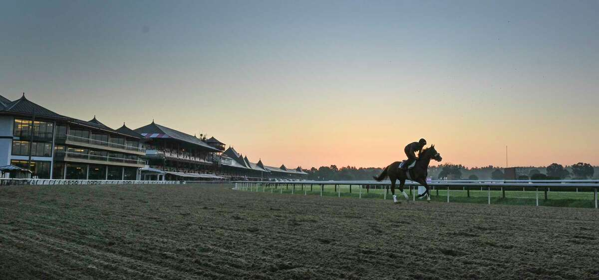 The New York Racing Association will start selling gift cards at Stewart's Shops on Thursday that are aimed at making it easier for betters to wager on horse races while Saratoga Race Course and other tracks in the state are closed by the coronavirus pandemic. In this photograph, horses gallop in the early morning the day before opening day at Saratoga Race Course July 15, 2020 in Saratoga Springs, N.Y. Photo by Skip Dickstein/Special to the Times Union.