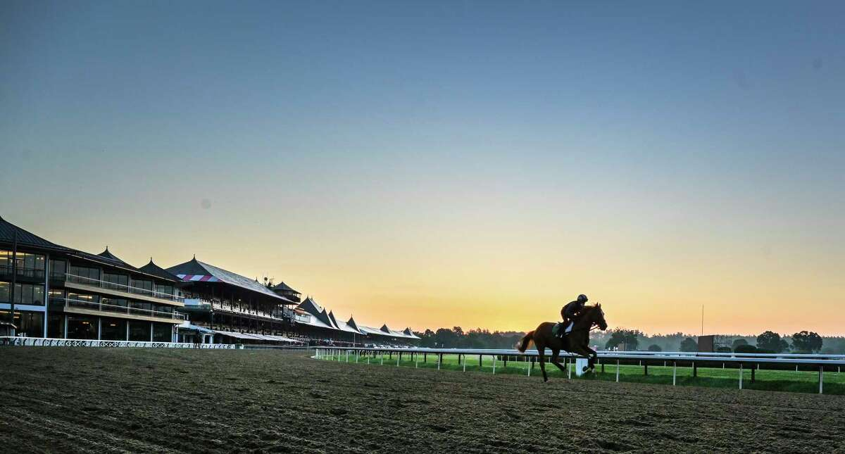 Horses gallop in the early morning the day before opening day at Saratoga Race Course July 15, 2020 in Saratoga Springs, N.Y. Photo by Skip Dickstein/Special to the Times Union.