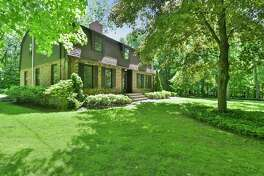 The antiqued brick and wood colonial house at 44 Wyldewood Road in Easton's Aspetuck neighborhood sits in a private setting of 3.07 acres.