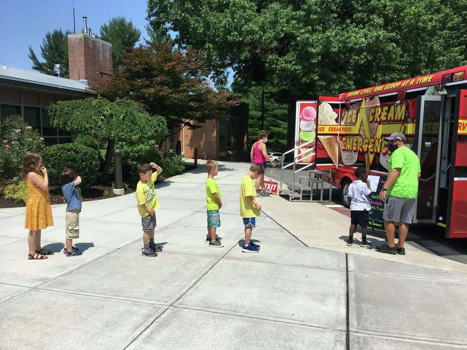During the age of the coronavirus, children attending Camp Looper wait their turn for ice cream. Photo: Contributed Photo / Visiting Nurse & Hospice / Wilton Bulletin Contributed