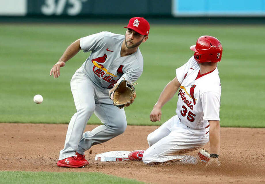 The Cardinals' Lane Thomas (35) is safe at second for a stolen base as infielder Max Schrock handles the throw during an intrasquad practice baseball game at Busch Stadium. Photo: Jeff Roberson | AP Photo