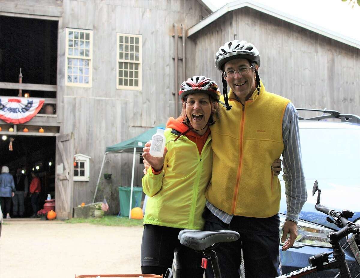 A pair of riders enjoy a moment at a farm stop on the Tour des Farms.