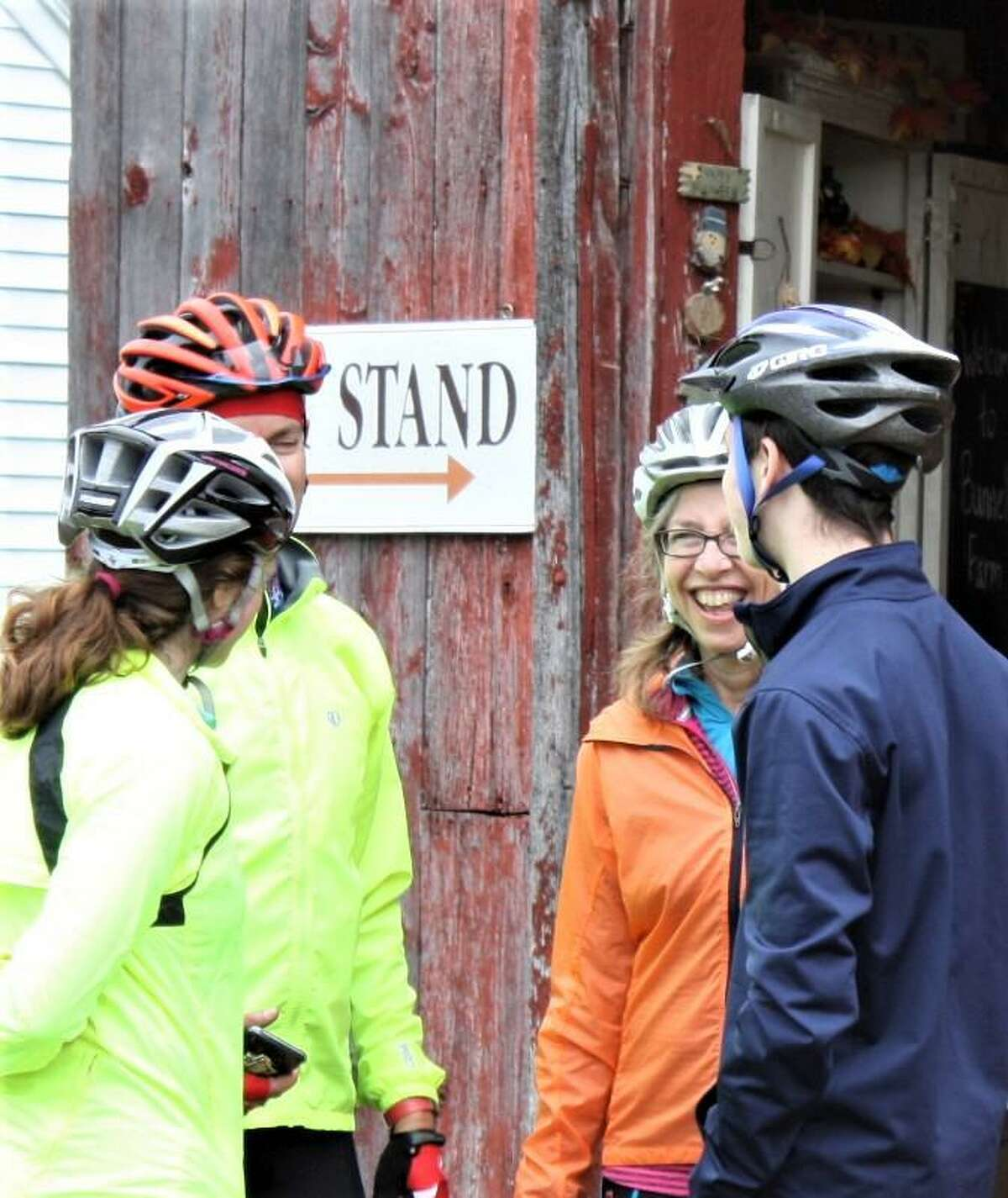 Riders pause at a barn during a previous Tour des Farms ride.