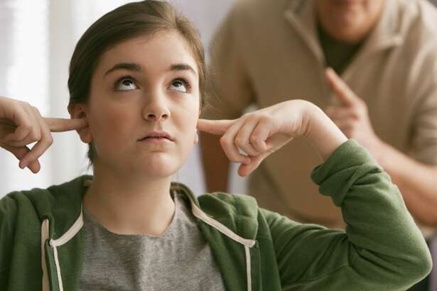 A daughter is attempting to please her verbally abusive father.