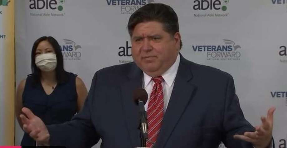 Gov. J.B. Pritzker takes questions at a news conference Tuesday in Chicago, only vaguely answering questions about what would be needed to drive some facets of the state's economy backward in its reopening effort.