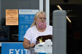 Customers and employees wear face masks after the governor's order last week.