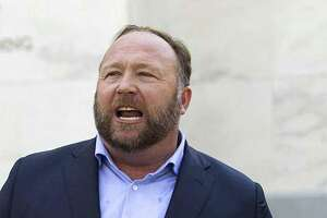 Conspiracy extremist Alex Jones speaks outside of the Dirksen building of Capitol Hill on Wednesday, Sept. 5, 2018, in Washington.