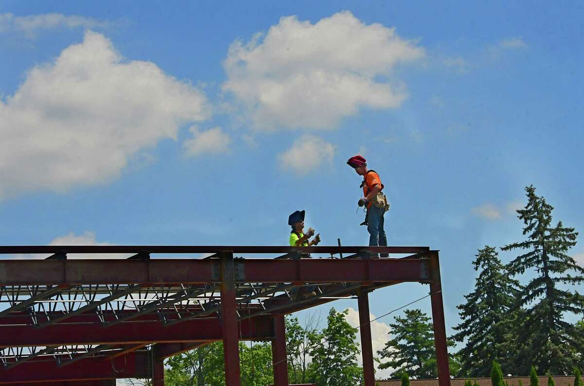 Welders are seen on top of a steel frame for the construction of a new Chase location on Wednesday, July 15, 2020 in Albany, N.Y. This construction site is on the corner of Homestead St. and Western Ave. where the former St. Margaret Mary's School was located. (Lori Van Buren/Times Union)