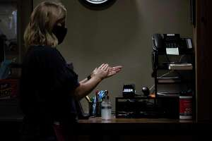 Customers and employees wear face masks after the governor's order last week. (Aurora Abraham/Huron Daily Tribune)