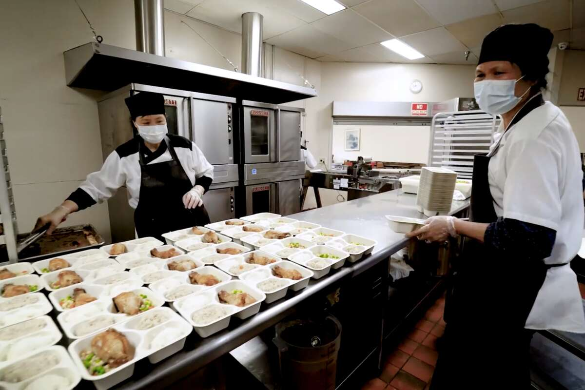 Moonstar Buffet staff work inside the kitchen to prepare meals for homebound seniors. One of the ways CEO Daisy Li has kept her staff working is through her second business, Moonstar Chef, where they prepare meals for seniors in need.