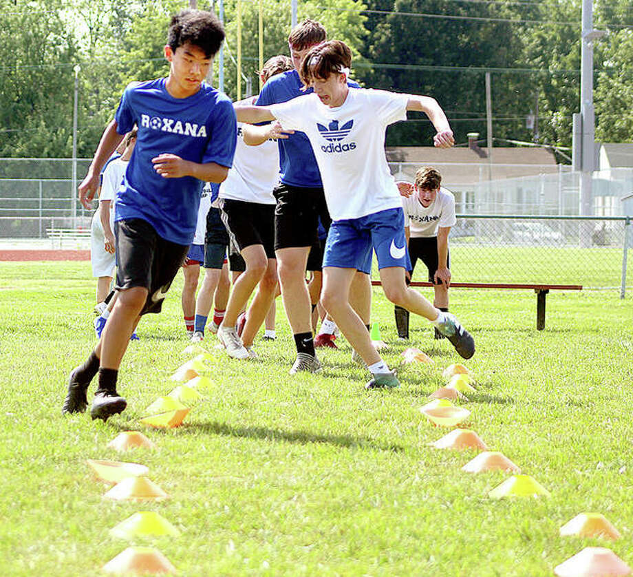 Roxana soccer players go through an agility and footwork drill during a 2019 summer practice. IHSA fall 2020 sports preseason practice and regular season remain in question because of the COVID-19 pandemic Photo: Pete Hayes | The Telegraph