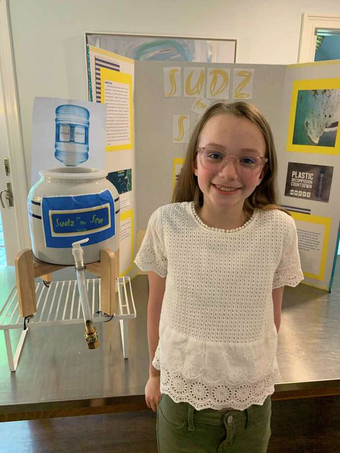 Georgia Anderson, a rising sixth grader, won state and national invention awards for Sudz for the Sea, a dispenser system aimed at reducing the amount of plastic reaching the world's oceans. Photo: Contributed Photo / Stephanie Anderson