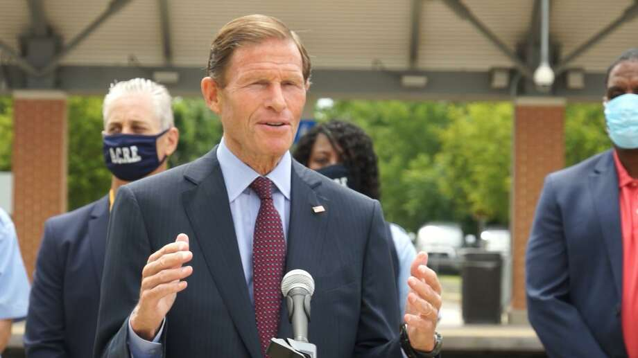 U.S. Sen. Richard Blumenthal, standing with employees from the Association of Commuter Rail Employees, called for further federal funding for Metro-North Wednesday in West Haven. Photo: CONTRIBUTED PHOTO /