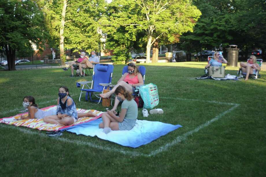 People attending the first CHIRP concert of the season wore masks and sat in socially distanced pods delineated in white in Ballard Parks' green grass. The next concert in the series is Friday, Aug. 28, at 7 p.m. featuring Tim Grimm and his Family Band. Photo: Macklin Reid / Hearst Connecticut Media