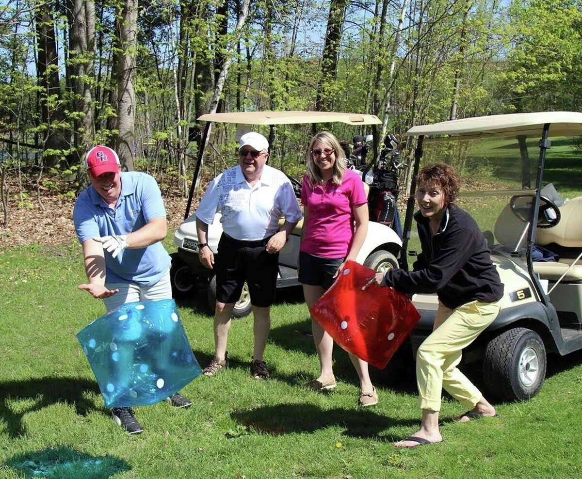 Golfers take part in a few side activities during the Pioneer Chamber Golf Open in 2019. (Pioneer file photo)