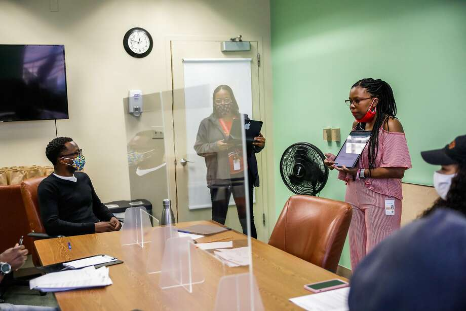 Essential worker Tonya Allen (second from right) leads a meeting at Hamilton Families, a shelter for unhoused families in the Tenderloin on Wednesday, July 1, 2020 in San Francisco, California. Photo: Gabrielle Lurie / The Chronicle