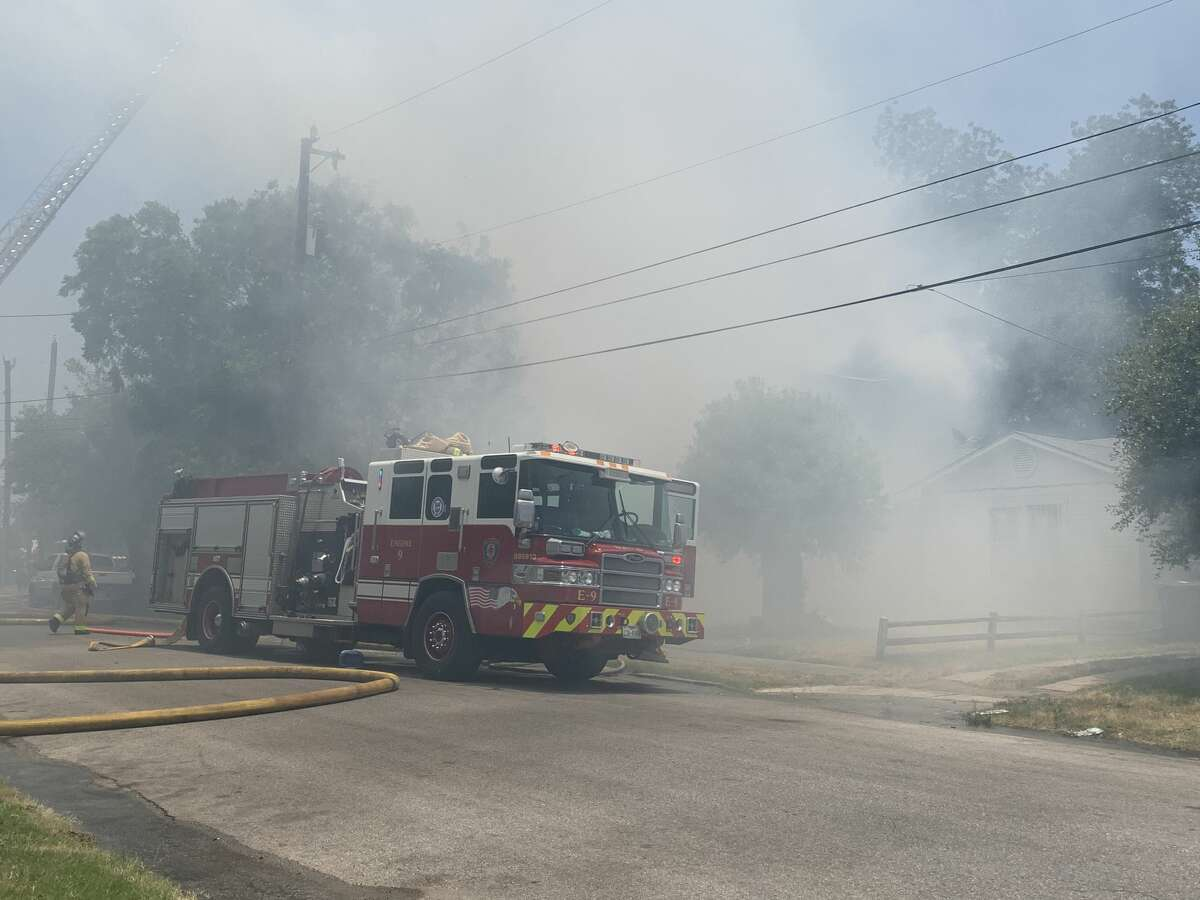 San Antonio firefighters are battling a two-alarm house fire downtown Wednesday afternoon on the 1200 block of Virginia Boulevard.