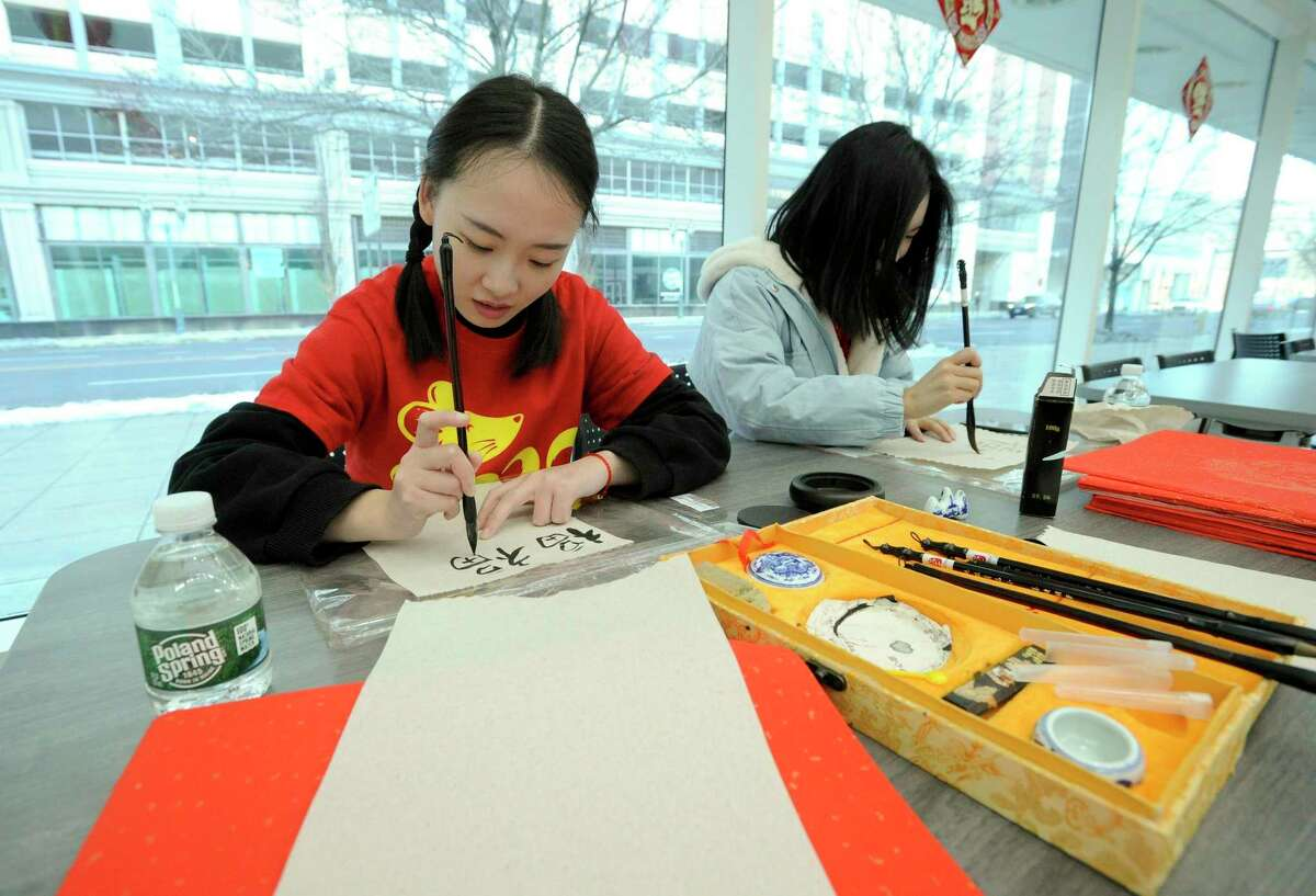 Hongyan Guo, a UCONN Stamford graduate student from China studying Business Analytics and Project Management, uses traditional Chinese calligraphy to celebrate the 2020 Lunar Year of the Rat during a international student celebration at the campus on Jan. 24, 2020 in Stamford, Connecticut.