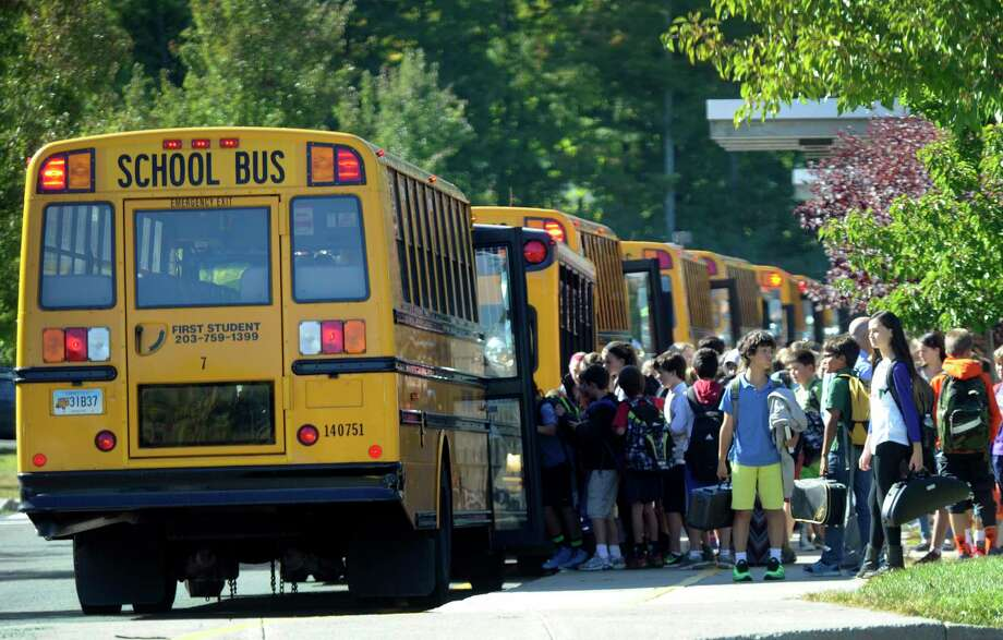 Students board buses at the end of the school day at Scotts Ridge Middle School in Ridgefield, Conn., Tuesday, Sept. 23, 2014. Photo: Carol Kaliff / Carol Kaliff / The News-Times