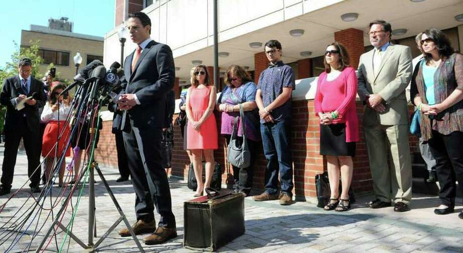 Attorney Joshua Koskoff stands with Sandy Hook family members as he speaks to a large group of media gathered in front of the Fairfield County Courthouse, in Bridgeport, Conn. June 20, 2016. Photo: Ned Gerard / Hearst Connecticut