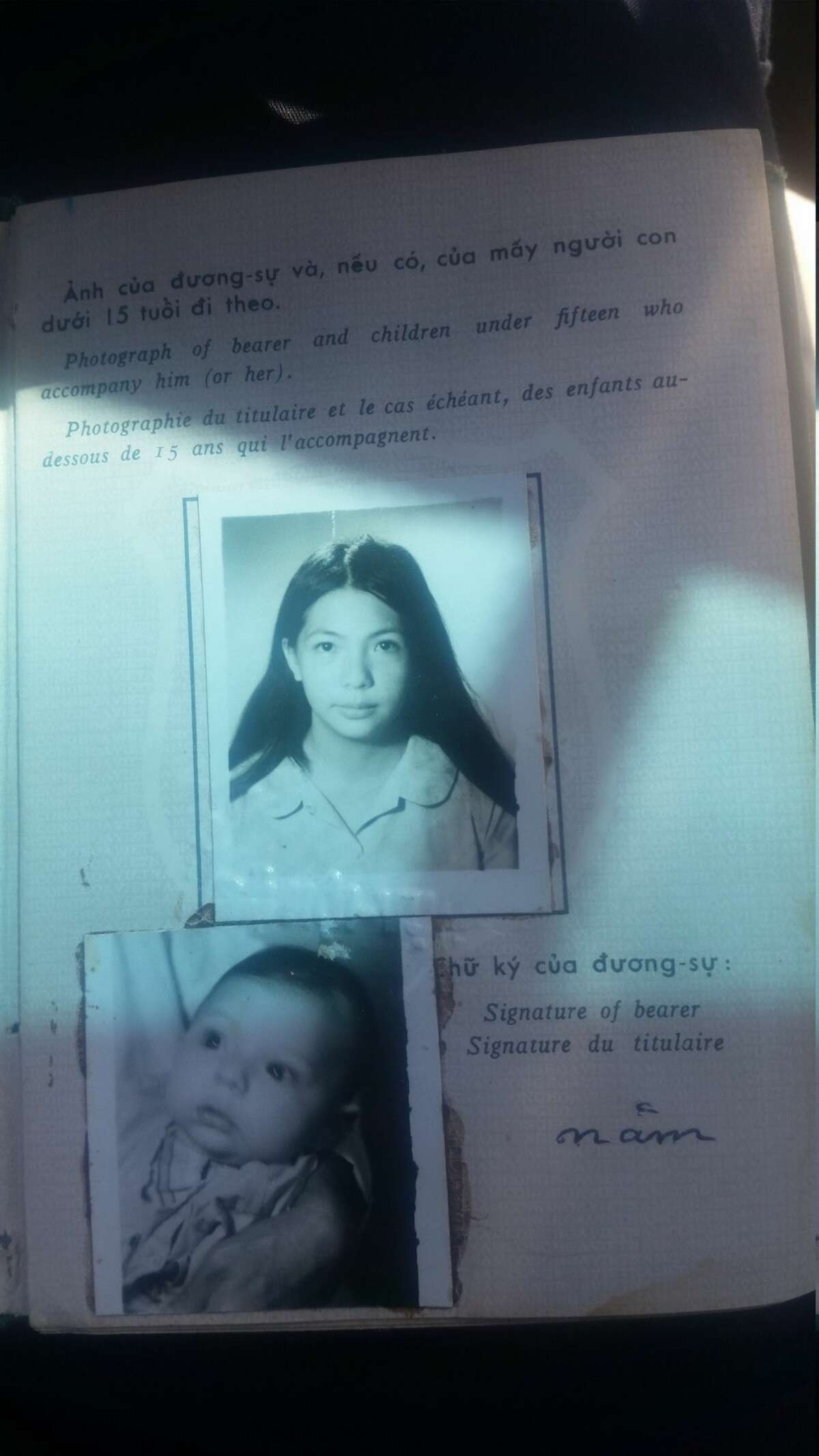Visa photographs of Kim Remzi as a baby and her mother.