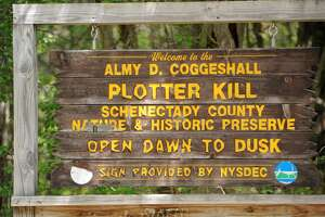 Sign at an entrance to the Plotter Kill Preserve's hiking trails on Monday, May 19, 2016 in Rotterdam, N.Y. Assemblyman Angelo Santabarbara held a press conference to announce $600,000 in state funds to fix the Plotter Kill Preserve's hiking trails. May 13 was first anniversary of Carly's Sinnott's death in a fall there. Her parents, Jim and Lynn Sinnott, spearheaded and raised money for effort. (Lori Van Buren / Times Union)