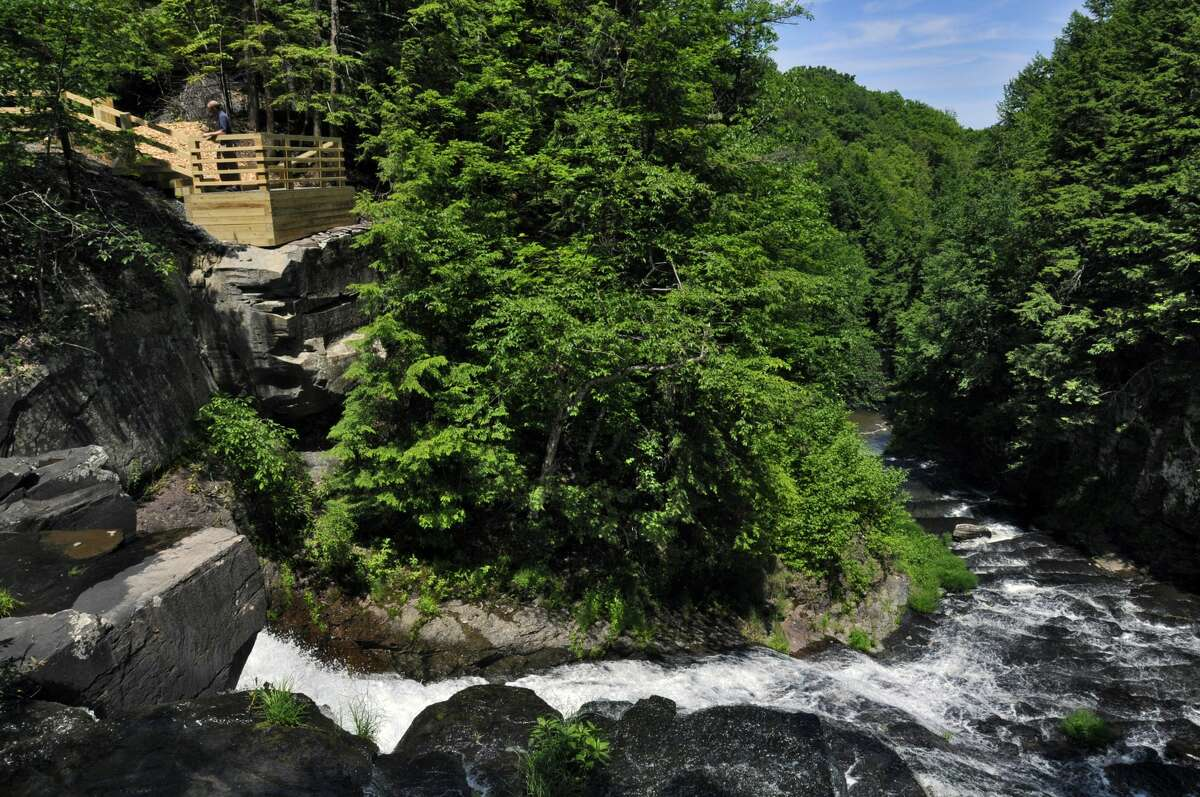 Chad Jemison, Director of the Huyck Preserve, stands on a viewing platform at the waterfall in the preserve in Rensselaerville, NY on Tuesday June 16, 2010. The platform will be opened for the public this weekend. FOR BRIAN NEARING STORY. ( Philip Kamrass / Times Union)