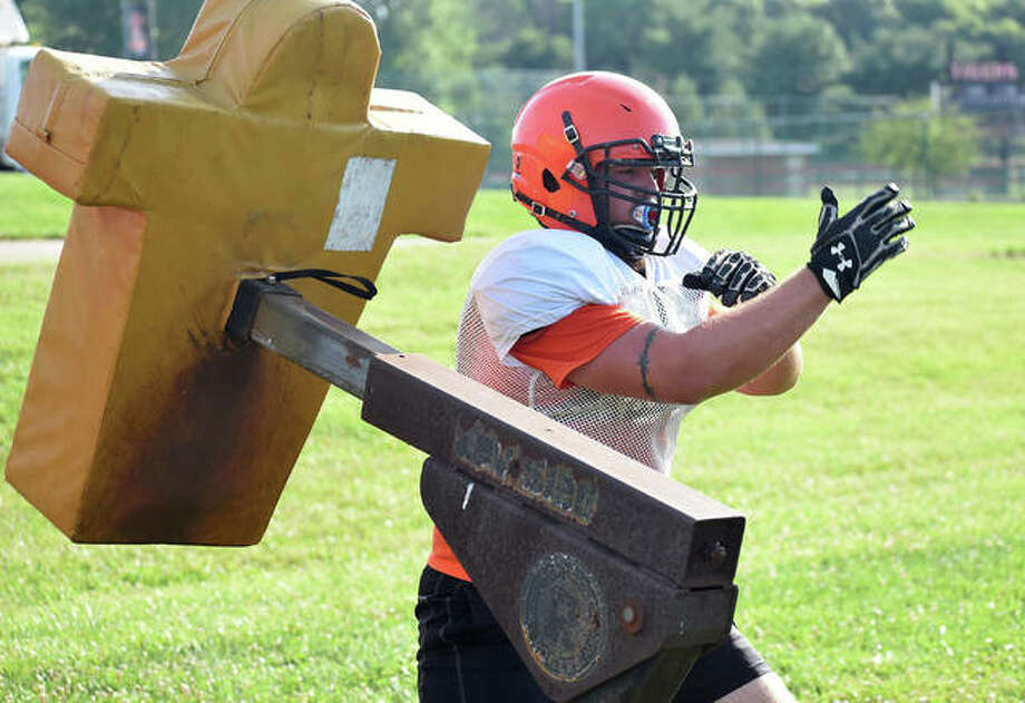 The Edwardsville football team conducted summer drills Tuesday morning inside the District 7 Sports Complex. Players were allowed to practice along as they wore masks when they weren't able to social distance from teammates and coaches. Photo: Matt Kamp|The Intelligencer