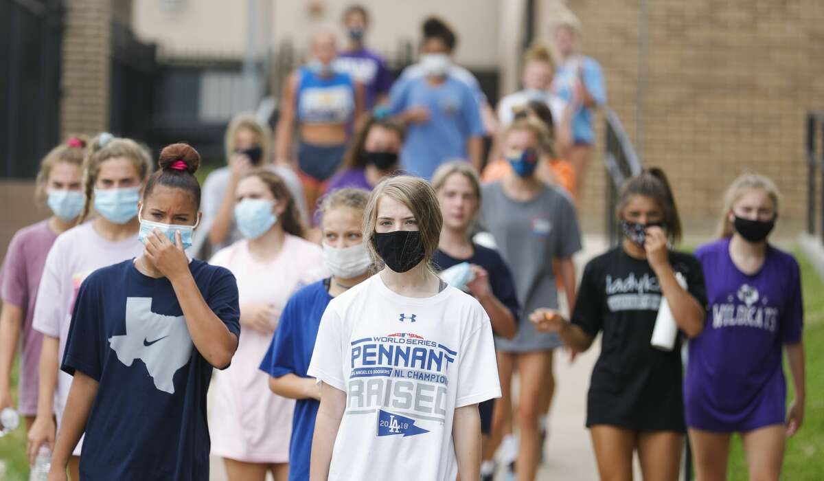 Willis athletes wear face mask as they move between stations during the school?•s Summer Pride strength and conditioning workout, Wednesday, July 15, 2020. The UIL allowed organized workouts to restart this week following a rise in coronavirus cases. Volleyball, football, cross country and team tennis are currently slated to begin their seasons Aug. 3.